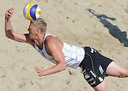 STARE JABLONKI POLAND - July 4:  Alison  Cerutti /1/ and Emanuel Rego of Brazil in action during Day 4 of the FIVB Beach Volleyball World Championships on July 4, 2013 in Stare Jablonki Poland.  (Photo by Piotr Hawalej)