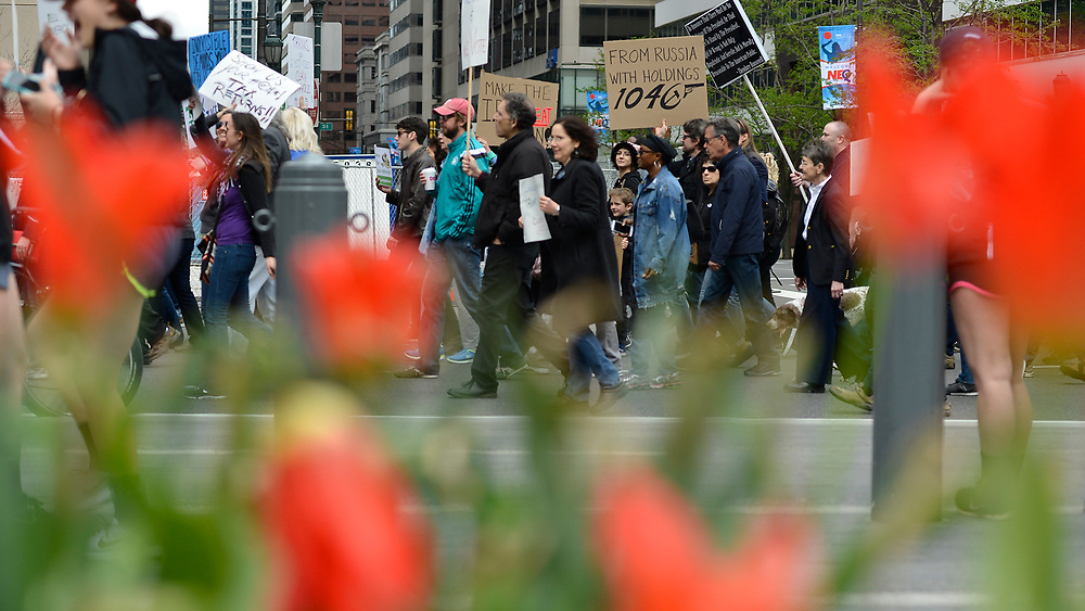 Protestors participate in a Tax Day March in Center City Philadelphia, on April 15, 2017. Around the nation thousands are expected to participate in similar protests against the Trump-administration. (Bastiaan Slabbers for NewsWorks)
