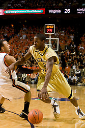 Georgia Tech guard Lewis Clinch (0) dribbles past Virginia guard Calvin Baker (4).  The Virginia Cavaliers men's basketball team fell to the Georgia Tech Yellow Jackets 92-82 in overtime at the John Paul Jones Arena in Charlottesville, VA on January 27, 2008.