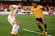 MKDons defender Baily Cargill (26) and Cambridge United's Jevani Brown(20) during the EFL Sky Bet League 2 match between Cambridge United and Milton Keynes Dons at the Cambs Glass Stadium, Cambridge, England on 13 October 2018.