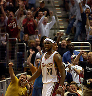 PHOTO BY DAVID RICHARD.LeBron James celebrates after a layup and foul on Washington yesterday in the opening game of the NBA playoffs.