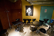 Corona Bar, a popular meeting point for young creatives and the art scene owned by famous director Aki Kaurisma?ki. A portrait of his favourite actor Matti Pellonpa?, who drank himself to death some time ago, hangs prominently in a cosy corner next to the bar.