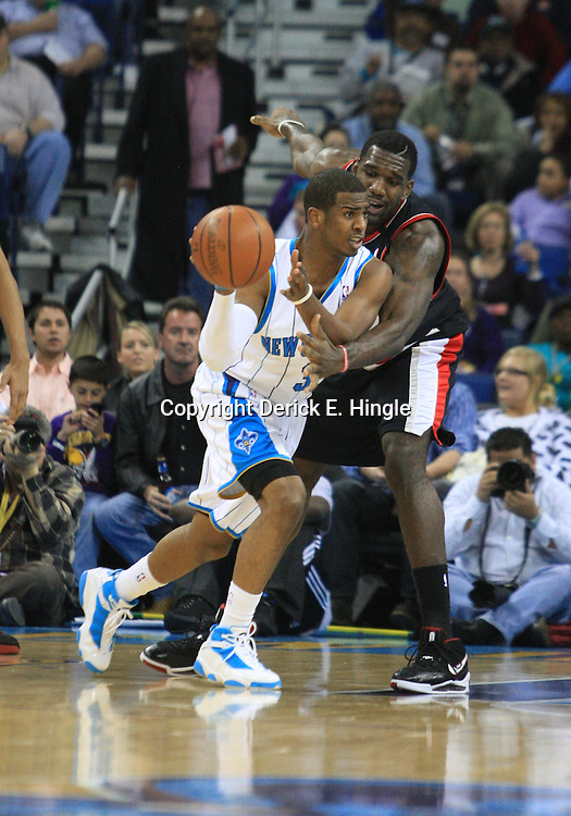 02 February 2009: New Orleans Hornets guard Chris Paul (3) passes as Portland Trailblazers center Greg Oden (52) defends during a 97-89 loss by the New Orleans Hornets to the Portland Trail Blazers at the New Orleans Arena in New Orleans, LA.