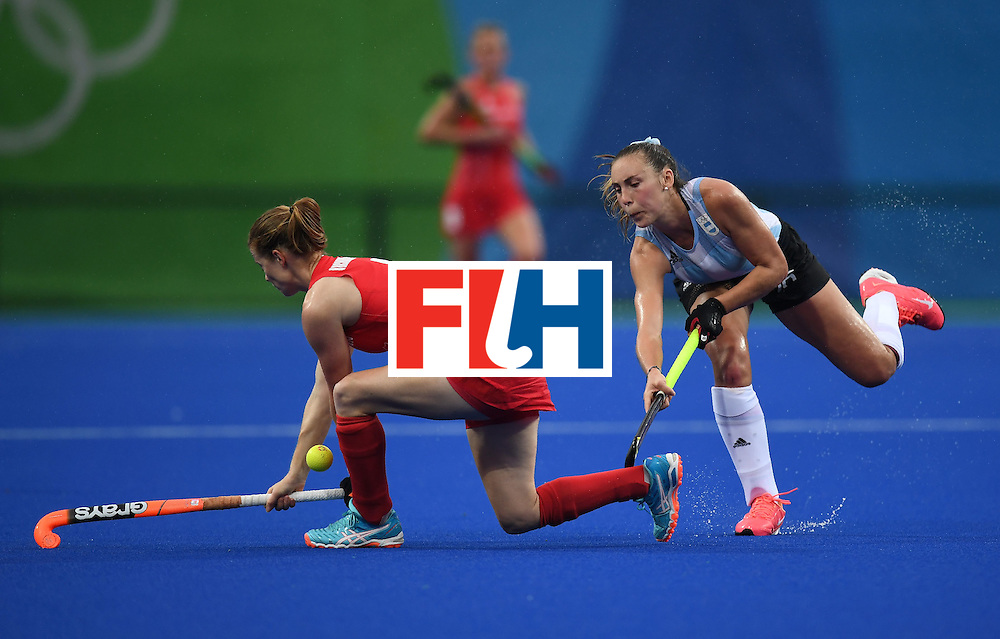 Britain's Helen Richardson-Walsh vies for the ball with Argentina's Florencia Habif during the women's field hockey Britain vs Argentina match of the Rio 2016 Olympics Games at the Olympic Hockey Centre in Rio de Janeiro on August, 10 2016. / AFP / MANAN VATSYAYANA        (Photo credit should read MANAN VATSYAYANA/AFP/Getty Images)