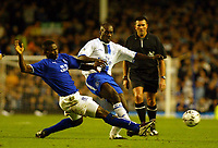 Photo: Scott Heavey.<br />Everton v Chelsea. FA Barclaycard Premiership. 01/11/2003.<br />Alex Nyarko slides in on Jimmy Floyd Hasselbaink