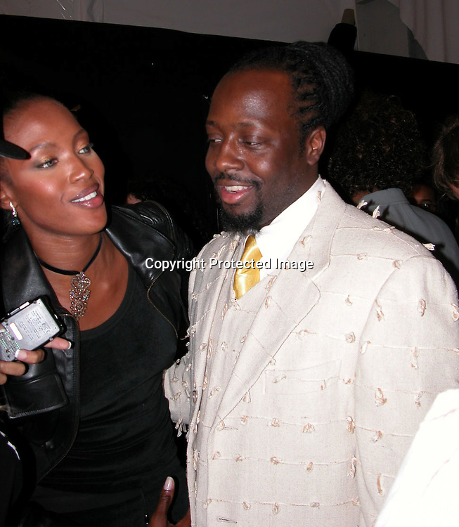 Naomi Campbell &amp; Wycleaf Jean <br />Fusha Fashion Show Front Row &amp; backstage<br />The Bryant Tent, Bryant Park<br />New York City, NY, USA<br />Saturday, September, 13, 2003 <br />Photo By Celebrityvibe.com/Photovibe.com