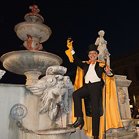 VENICE, ITALY - FEBRUARY 19:  DJ Prince Miichael, toasts to the crowd by the wine fountain in St Mark Square on February 19, 2011 in Venice, Italy. The fountain pouring wine features today during the Gran brindisi a Venezia or Grand Toast in Venice the opening ceremony of this year Carnival .