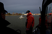 BM2 Steven Klika and  Executive Petty Officer Jeff Ritter, left, of U.S. Coast Guard, patrols the Potomac River as a part of security measures taken for the Presidential Inauguration ceremonies in Washington, D.C., on January 21, 2013.
