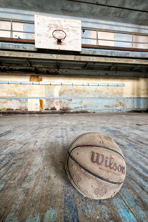 This basketball court is inside a semi-abandoned out of service public high school in Pennsylvania which closed in the early eighties. It has been left to fade away but for the efforts of one man attempting to turn it into a community center in an old anthracite coal town that itself is fading away. Being such a large building to rehab, there's only so much one person can achieve, and the gymnasium isn't high on the fix-it list.<br />