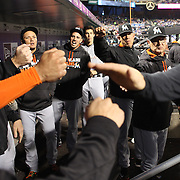 NEW YORK, NEW YORK - APRIL 11: Manager Don Mattingly, (right), Miami Marlins and team mates congratulate Chris Johnson on scoring a run as he returns to the dugout during the Miami Marlins Vs New York Mets MLB regular season ball game at Citi Field on April 11, 2016 in New York City. (Photo by Tim Clayton/Corbis via Getty Images)