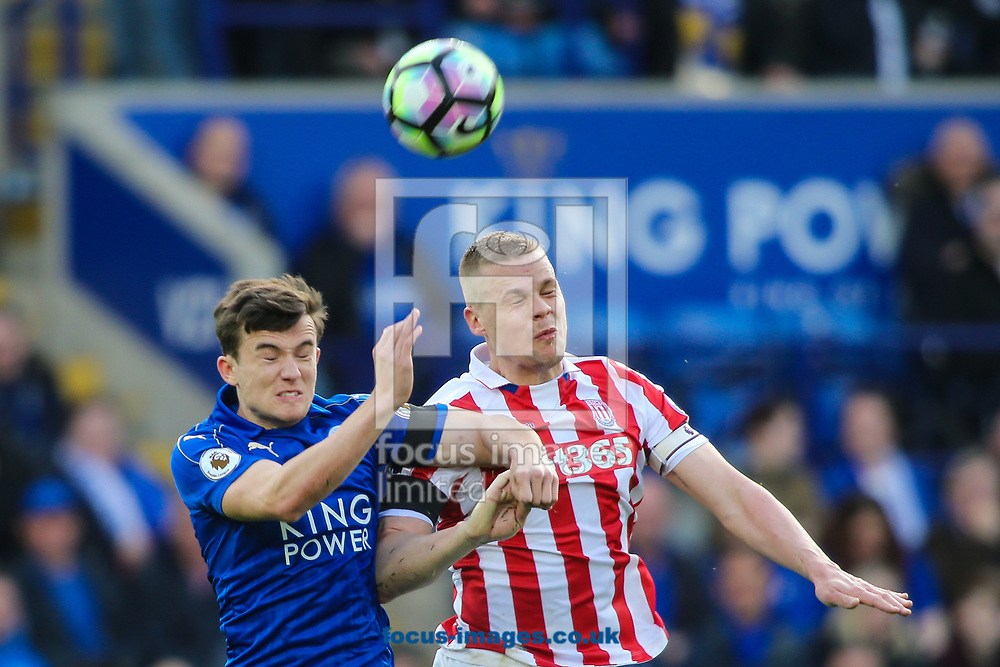 Ben Chilwell of Leicester City (left) competing with Ryan Shawcross of Stoke City (right) in the air during the Premier League match at the King Power Stadium, Leicester<br /> Picture by Andy Kearns/Focus Images Ltd 0781 864 4264<br /> 01/04/2017
