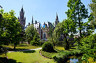 A view on the Peace Palace in The Hague with the garden in front of the Peace Palace and the flag of the UN (United Nations) The Peace Palace houses the Inernational Court of Justice, the Permanent Court of Arbitration, the Hague Academy of International Law and the Peace Palace Library.