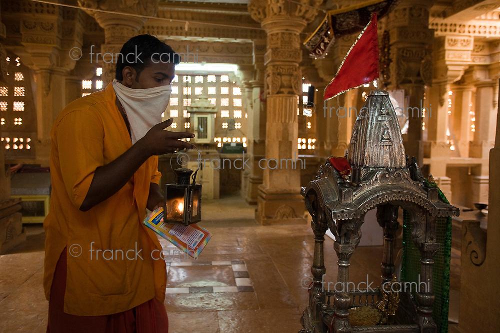 jain priest praying temple of lodruva jaisalmer in rajasthan state in india