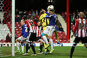 Cardiff City midfielder, Anthony Pilkington (13) challenging Brentford goalkeeper, David Button (27) during the Sky Bet Championship match between Brentford and Cardiff City at Griffin Park, London, England on 19 April 2016. Photo by Matthew Redman.