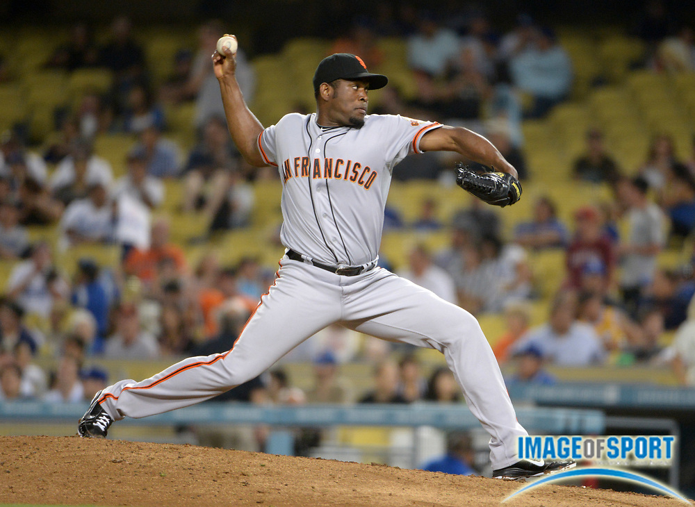 Aug 22, 2012; Los Angeles, CA, USA; San Francisco Giants reliever Santiago Casilla (46) delivers a pitch against the Los Angeles Dodgers at Dodger Stadium. The Giants defeated the Dodgers 8-4.