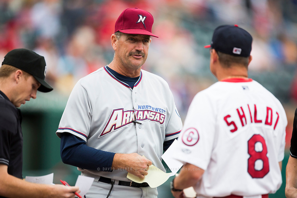 Manager Brian Poldberg (27) of the Northwest Arkansas Naturals  talks with Manager Mike Shildt (8) of the Springfield Cardinals prior to a game against the Springfield Cardinals at Hammons Field on July 28, 2013 in Springfield, Missouri. (David Welker)