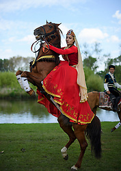 © London News Pictures. 15/05/2016. Windsor, UK. A rider from the Azerbaijan Dancers and Karabakh Riders  team, rears her horse on the banks of the River Thames on the final day of the 2016 Royal Windsor Horse Show, held in the grounds of Windsor Castle in Berkshire, England. This years event is part of HRH Queen Elizabeth II's 90th birthday celebrations.  Photo credit: Ben Cawthra/LNP