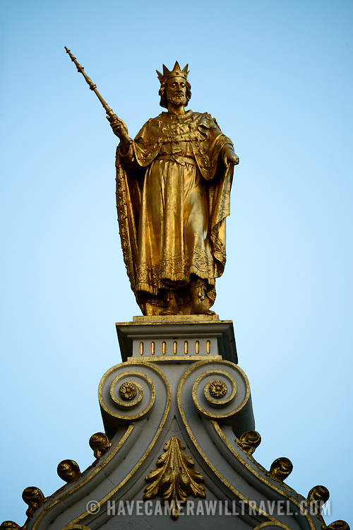 Gold statue of a king on top of the Oude Griffie building (Old Office, or Old Recorders House) on Burg Square in historic Brudges, Belgium.