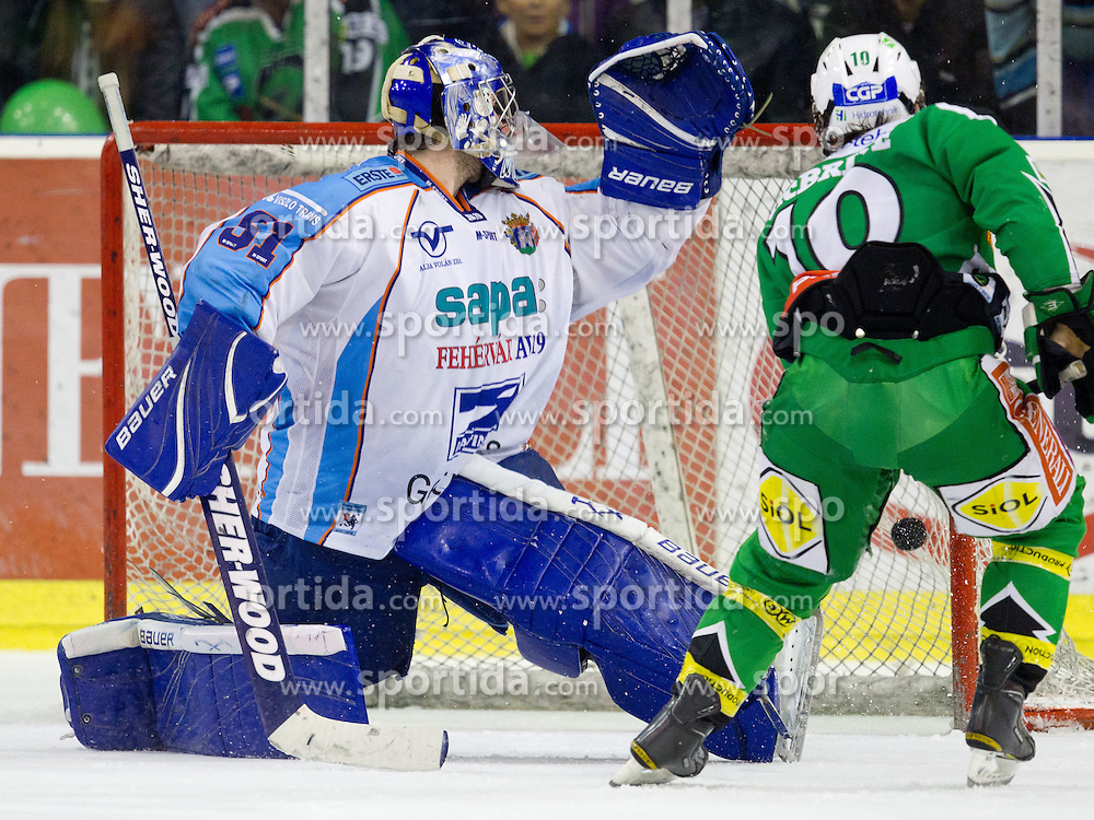 Brock McBride (HDD Tilia Olimpija, #10) scores a goal on Adam Munro (SAPA Fehervar AV19, #51) during ice-hockey match between HDD Tilia Olimpija and SAPA Fehervar AV19 at sixth match in Quarterfinal  of EBEL league, on March 1, 2012 at Hala Tivoli, Ljubljana, Slovenia. HDD Tilia Olimpija won 4:3. (Photo By Matic Klansek Velej / Sportida)