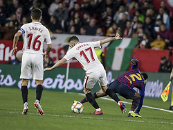 January 23, 2019 - Seville, Spain - SEMEDO of Barcelona (R) vies for the ball with PABLO SARABIA of Sevilla (L) during the King's Cup quarter-final first leg soccer match between Sevilla FC and FC Barcelona at Sanchez Pizjuan Stadium (Credit Image: © Daniel Gonzalez Acuna/ZUMA Wire)
