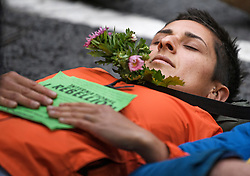 © Licensed to London News Pictures. 08/10/2019. London, UK. An Extinction Rebellion activists lies on the floor and refuses to move outside Home Office in Westminster. Activists have converged on Westminster for a second day, blockading roads in the area and calling on government departments to 'Tell the Truth' about what they are doing to tackle the Emergency. Photo credit: Ben Cawthra/LNP