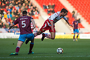 Doncaster Rovers Midfielder Matty Blair (17) is tackled be Scunthorpe United defender Murray Wallace (5) during the The FA Cup match between Doncaster Rovers and Scunthorpe United at the Keepmoat Stadium, Doncaster, England on 3 December 2017. Photo by Craig Zadoroznyj.