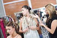 Fashion model and stylist in dressing room