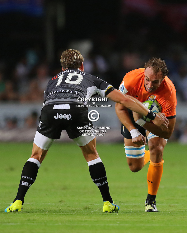 DURBAN, SOUTH AFRICA, 5, MARCH, 2016 -  Joe Pietersen of the Cell C Sharks looks to tackle Leonardo Senatore of the Jaguares during The Cell C Sharks vs Jaguares Super Rugby match at Growthpoint Kings Park in Durban, South Africa. (Photo by Anesh Debiky)