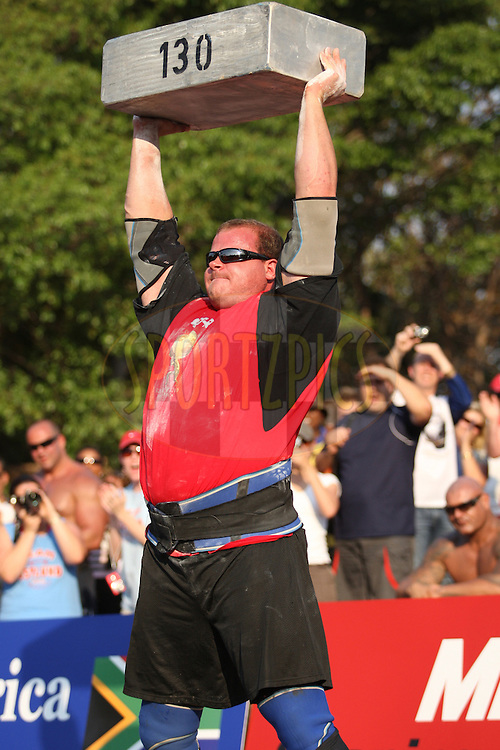 Dave Ostlund (USA) successfully lifts the 130kg metal block during one of the qualifying rounds of the World's Strongest Man competition held in Sun City, South Africa.