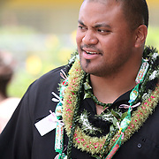 Will Lobendahn, terminated Monday as Kaiser High School's Head Football Coach, enjoys time with students from the Samoan presentation at the school's May Day held on campus in the gymnasium.  Photo by Barry Markowitz, 5/4/12, 11:31am