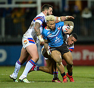 Craig Huby (L) &amp; Reece Lyne of Wakefield Trinity tackle Junior Sau of Salford Red Devils during the Betfred Super League match at Belle Vue, Wakefield<br /> Picture by Richard Land/Focus Images Ltd +44 7713 507003<br /> 09/02/2018