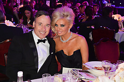 DAVID FURNISH and CLAIRE CAUDWELL at the Caudwell Children's annual Butterfly Ball held at The Grosvenor House Hotel, Park Lane, London on 15th May 2014.