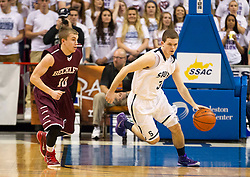 Parkersburg South guard Cody Monroe (3) drives past Woodrow Wilson guard Corey Acord (10) during a semi-final game at the Charleston Civic Center.