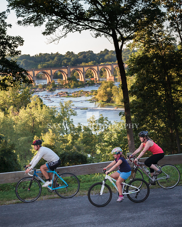 """ 10 Great Bike Rides "" feature, cover, family of cyclist with scenic view of James River"