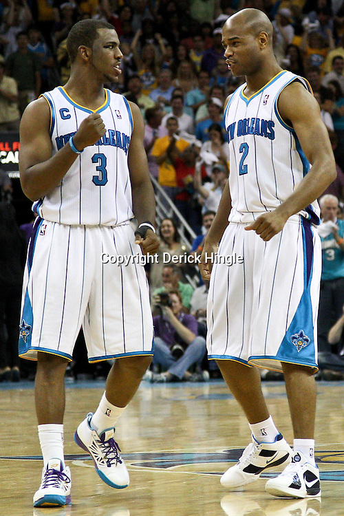 April 24, 2011; New Orleans, LA, USA; New Orleans Hornets point guard Chris Paul (3) and point guard Jarrett Jack (2) react during the fourth quarter in game four of the first round of the 2011 NBA playoffs against the Los Angeles Lakers at the New Orleans Arena. The Hornets defeated the Lakers 93-88.   Mandatory Credit: Derick E. Hingle