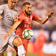 MEADOWLANDS, NEW JERSEY- August 7:   Karim Benzema #9 of Real Madrid is challenged by Aleksandar Kolarov #11 of AS Roma during the Real Madrid vs AS Roma International Champions Cup match at MetLife Stadium on August 7, 2018 in Meadowlands, New Jersey. (Photo by Tim Clayton/Corbis via Getty Images)