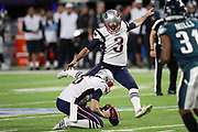 New England Patriots punter Ryan Allen (6) holds while New England Patriots kicker Stephen Gostkowski (3) kicks a 26 yard field goal that ties the score at 3-3 in the first quarter during the 2018 NFL Super Bowl LII football game against the Philadelphia Eagles on Sunday, Feb. 4, 2018 in Minneapolis. The Eagles won the game 41-33. (©Paul Anthony Spinelli)