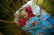 A boy sleeps in a crib at an orphanage in Slutsk on April 18, 2006. Orphanages and asylums for physically and mentally handicapped children and adults receive very little funding from the government, instead they rely heavily on donations and supplies from foreign organizations.