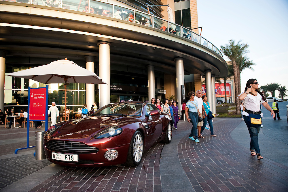 Expensive cars pull up to the valet parking area at Dubai Mall, in front of the Burj Khalifa, Dubai, UAE on Friday, February 12, 2010.