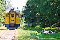 Via Rail train service entering the Qualicum Beach train station.  Qualicum Beach, Vancouver Island, British Columbia, Canada.