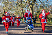 There it is, happy to be nearing the finish - 2000 Santas of all ages take part in the annual Santa Run in Battersea Park to support Noah's Ark Children's Hospice.