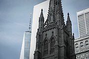 THE ALMIGHTY DOLLAR: The new 1 World Trade Center towering in the background of Trinity Church near Wall Street.