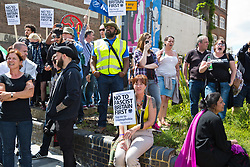 Luton, UK. 27th June, 2015. Local residents join anti-racist activists from Unite Against Fascism to protest against a march by far-right group Britain First. A large police presence kept the two groups apart.