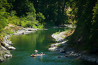 The Cowichan River near Skutz Falls is a meca for summertime enthusiasts, most notably, the many tubers that float down the river throughout the summer months.  Skutz Falls, Cowichan River, Vancouver Island, British Columbia, Canada.