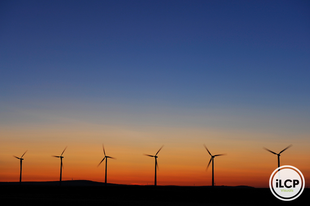 Wind turbines at sunset, Flathead River Valley, British Columbia, Canada.
