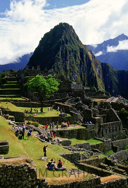 Tourists visit Machu Picchu ruins of Inca citadel in Peru, South America