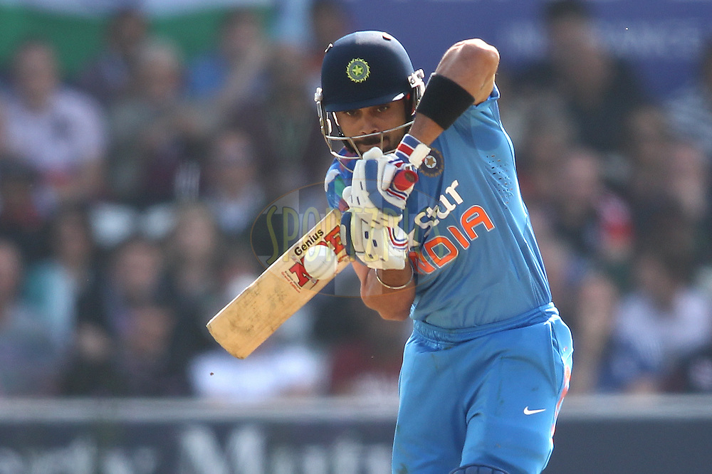 Virat Kohli of India looks to play a short delivery during the 5th One Day International ( ODI ) match between England and India held at Headingley Cricket Ground in Leeds, England on the 5th September 2014<br /> <br /> Photo by Shaun Roy / SPORTZPICS/ BCCI