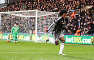 Willian of Chelsea scores a screamer to make it 0-2 and celebrates during the Barclays Premier League match between Crystal Palace and Chelsea at Selhurst Park, London, England on 3 January 2016. Photo by Ken Sparks.