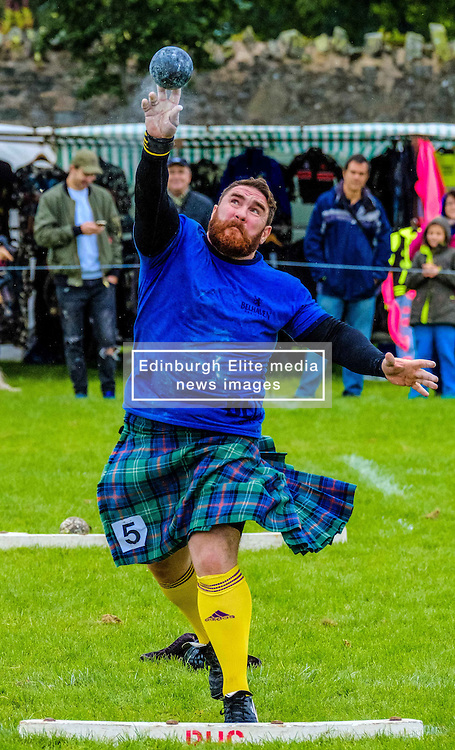 Peebles, Scotland UK  3rd September 2016. Peebles Highland Games, the biggest 'highland' games in the Scottish  Borders took place in Peebles on September 3rd 2016 featuring pipe band contests, highland dancing competitions, haggis hurling, hammer throwing, stone throwing and other traditional events.<br /> <br /> Pictured:  a competitor in the shot put competition<br /> <br /> (c) Andrew Wilson | Edinburgh Elite media