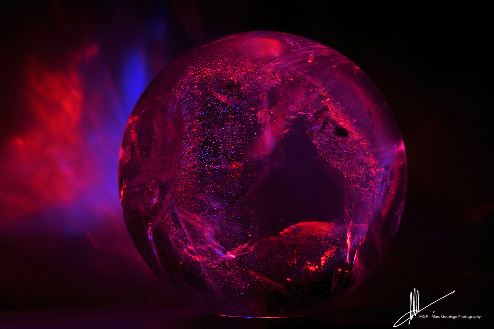 Quartz crystal sphere with red and blue moods